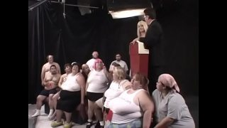 Two dozens of lard-asses suck, lick and fuck each other during The Worlds First Gang Bang